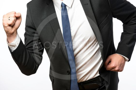 Businessman on the move with clenched fists