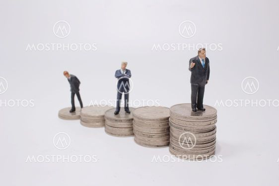 financial concepts. figure standing on stack of coin