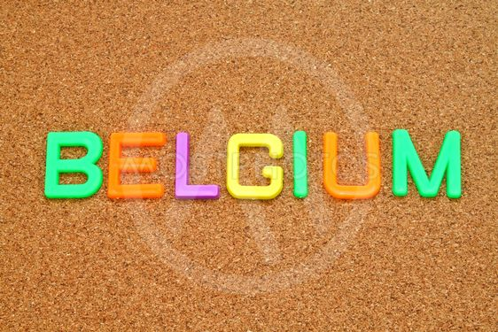 Belgium in colorful toy letters on cork background