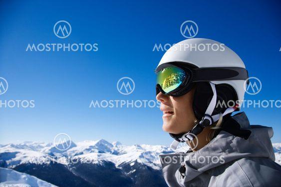 Boy snowboarder in mountains.