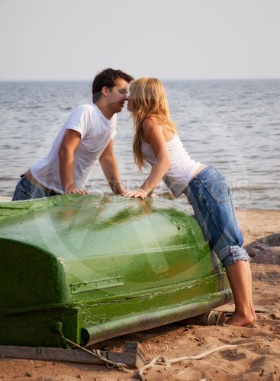beautiful couple kissing on a beach