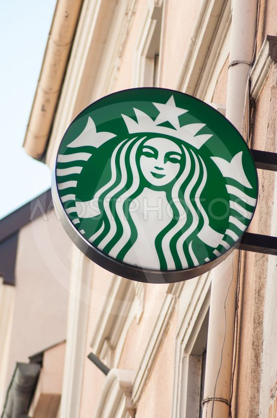 Starbucks logo on coffee shop entry in the street