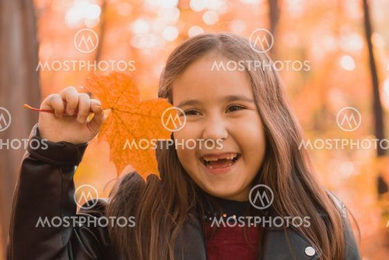 Autumn emotional portrait of laughing child walking in...