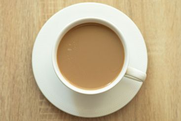 Top view of coffee with cream on a wooden table