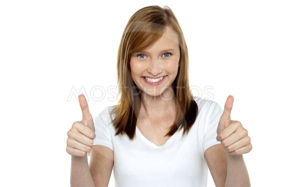 Pretty teenager gesturing double thumbs up