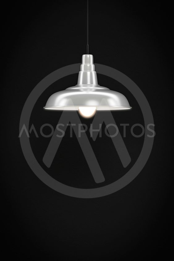 white lamp in front of a dark wall