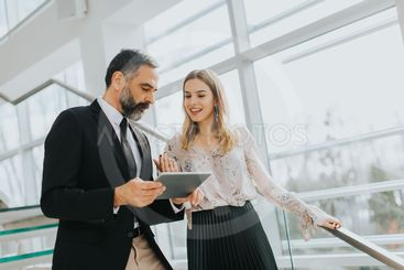 Business couple with digital tablet in office