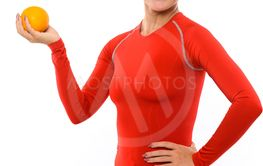 Fit woman holding orange