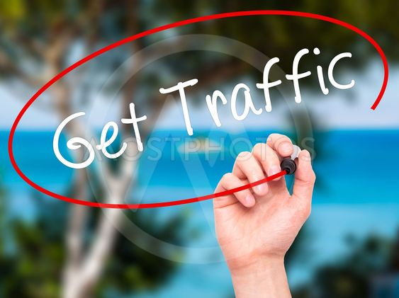 Man Hand writing Get Traffic with black marker on visual...