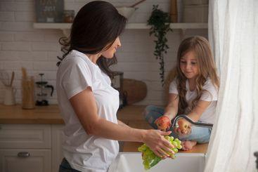 Happy loving family preparing food together. Smiling Mom...