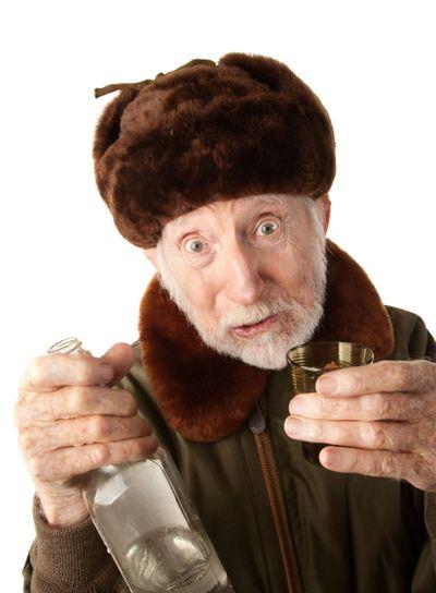 Russian Man in Fur Cap with Vodka