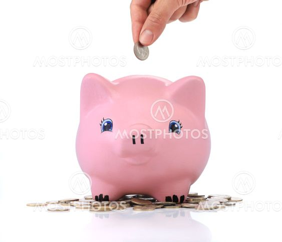 Savings. Pink piggy bank with coins around