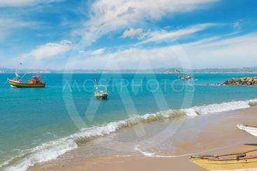 Fishing boat on the sandy shore against a background the...