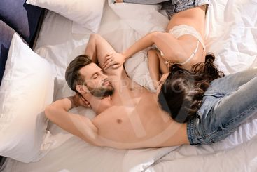 beautiful sexy couple sleeping in bed at home in morning