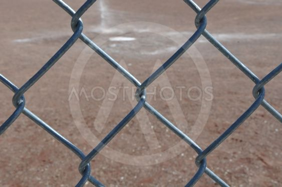 Home Plate Baseball behind Chain Link Fence