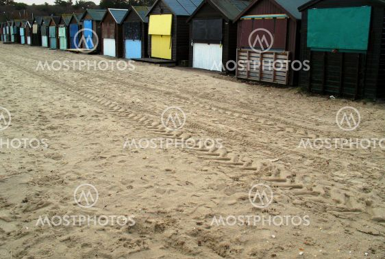 Beach huts and sand tracks