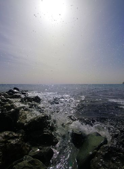 Ocean water splashing on cliffs