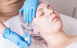 Hands of cosmetologist are close-ups that inject...