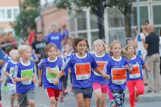 Group of smiling girls and boys running