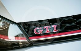 GTI sign on grey Volkswagen Golf GTI front parked in the...