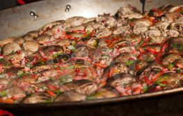 chicken and peppers in a big stove in outdoor