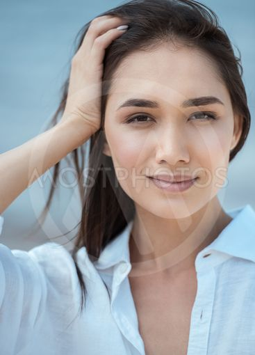 close up portrait of attractive asian woman with hand in...