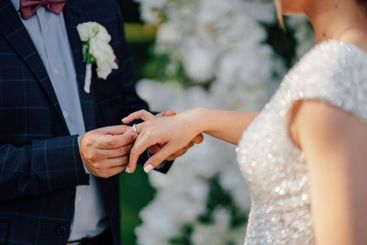 groom and bride put on each other rings.