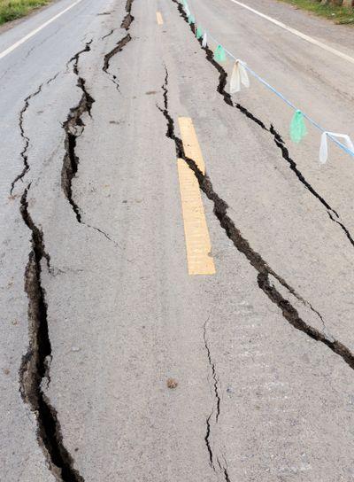 Cracked and broken asphalt Road.