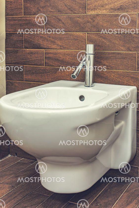 White mounted toilet bidet in modern bathroom
