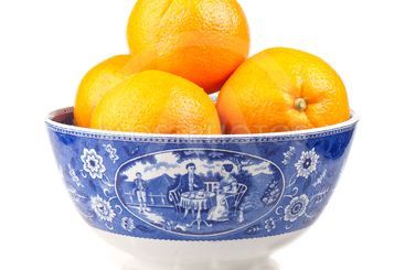 Oranges in an ancient hand-painted bowl