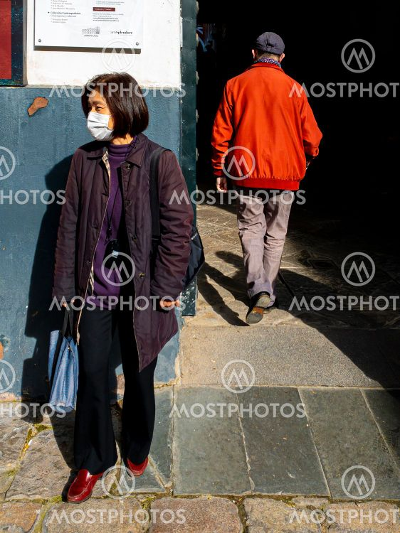 Unidentified woman in Seville Spain wearing mask to...