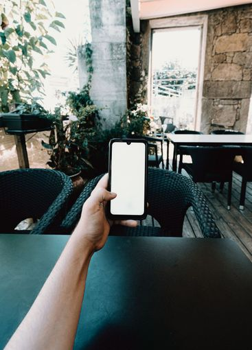 Self point of view of a mobile phone screen on a bar...