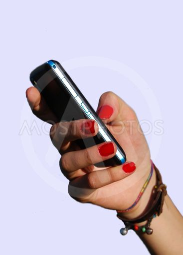 Phone in the adolescent hand