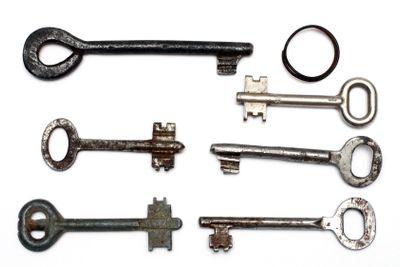 six old rusty keys and keyring