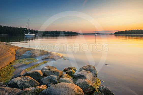 Tranquil scene with sailboats moored for the night