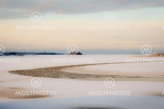 Frozen sea with open water