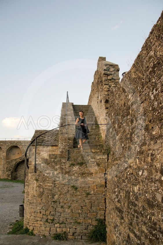 Carol on a stone stair. Lateral look.