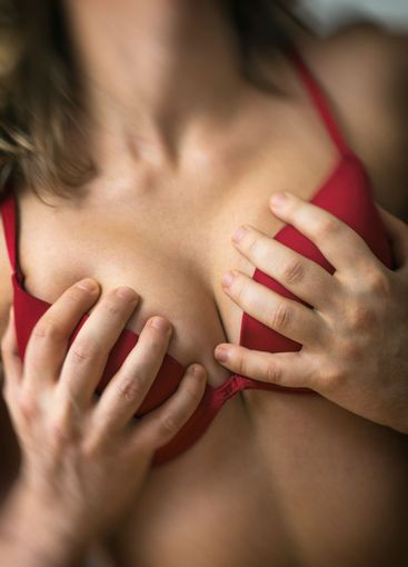 Couple in passion. Man hands on female breasts.