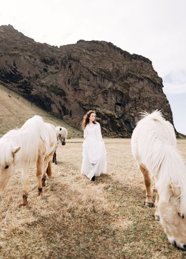 The bride in a white wedding dress walks across the...