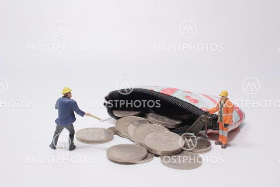 a mini figure stacked coins in a bucket