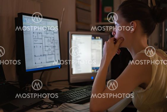 Young woman working at home, remote location, using...