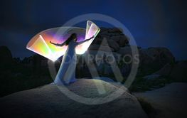 Person Light Painted in the Desert Under the Night Sky