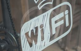 wifi free sign on cafe window in the street
