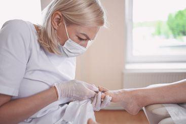Professional medical pedicure procedure using nail...