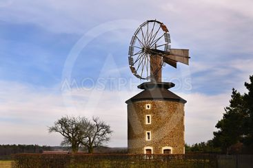 Beautiful old windmill at sunset with sky and clouds....