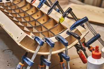 Joinery. Plywood bending process. Gluing and clamping...
