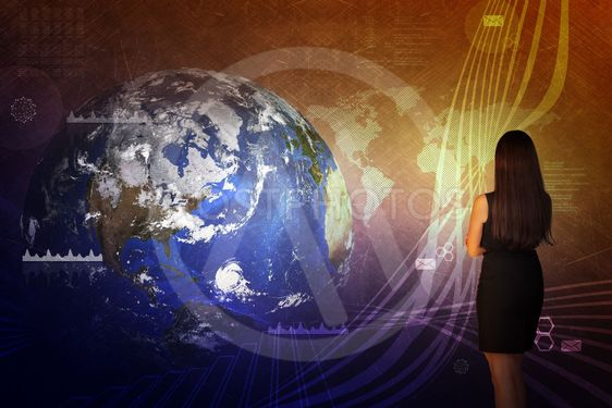 Businesswoman in front of world map