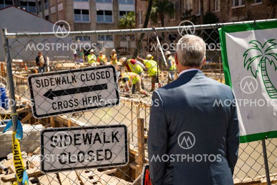 A man look at a street site under construction