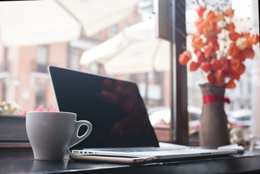 Coffee cup , laptop in coffee shop , for business,