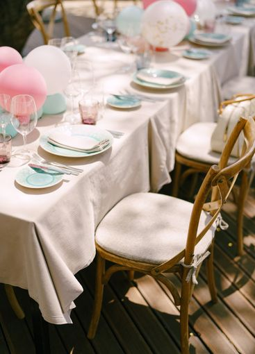 Wedding dinner table reception. A rectangular table in...